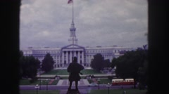 1958: an elevated statue faces across the center of a formal government Stock Footage