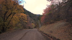 Side by Side UTV approaches on Mountain road Autumn leaves Arkistovideo