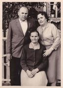 Family portrait of elderly woman and her brother with his wife (vintage photo) Stock Photos