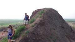 Aerial of Couple Trekking on Mound Stock Footage
