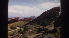 1958: rocky mountainous area with sparse vegetation under the cloudy sky Stock Footage