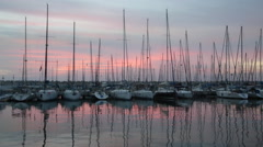 Port with docked yachts at sunset Stock Footage
