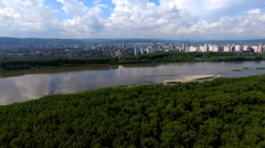 A city on the banks of the river from a height Stock Footage
