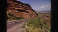 1958: red rocks denver area classic car driving past monoliths. COLORADO Stock Footage