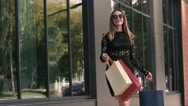 Fair-haired beautiful young woman is glad with her shopping day Stock Footage