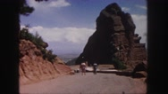 1958: two people people walking down a dirt road to an outdoor amphitheater Stock Footage