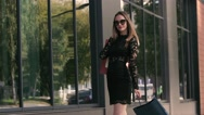Happy beautiful woman excited with her shopping turn around. Slow motion Stock Footage