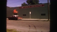1958: cars parked at curbs between street and front of individual buildings. Stock Footage