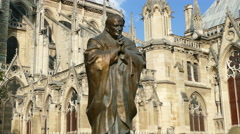 Paris. Pope John Paul II statue outside Notre Dame Cathedral. Stock Footage