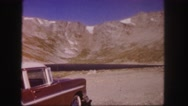 1958: view of a mountain ridge from a roadside stop while tourists take pictures Stock Footage