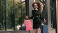 Happy smiling young woman cheerful in bliss enjoys her successful shopping Stock Footage