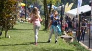 Children playing dancing outdoors on green lawn - active kids have fun Stock Footage
