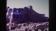 1958: a large structure made of stone with windows on rugged terrain COLORADO Stock Footage