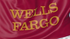 Close up of waving flag with Wells Fargo logo, seamless loop, blue background Stock Footage