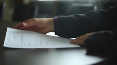 Low angle view of male hand signing contract or subscription form with a pen on Stock Footage