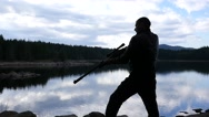 Man silhouette in nature makes a shot from an air rifle in slow motion Stock Footage
