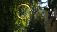 Soap bubble fly in air outdoors in park sunny weather slow motion Stock Footage
