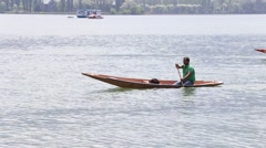 People use boat for transportation in lake. Srinagar, India Stock Footage