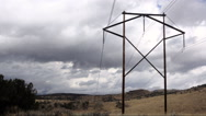 C11110900-Time lapse-clouds rolling over autumn hills-Electrical tower Stock Footage