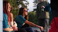 Cute pretty teenager girl sit smoking cigarette in public place slow motion Stock Footage