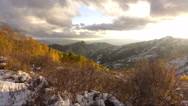 Time lapse-Sunlight shadow Snowy mountains Golden fall aspen trees. Stock Footage