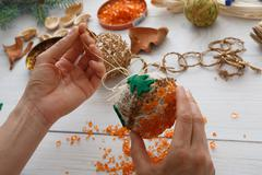Creative diy hobby. Handmade craft christmas decoration, balls and garland Stock Photos