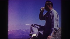 1958: man talking to another person while enjoying nature and sitting outside Stock Footage