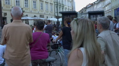 Many people have gathered in the city center for a street performance Stock Footage