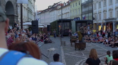 Street performance in front of a town hall Stock Footage