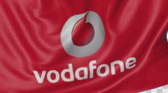 Close up of waving flag with Vodafone logo, seamless loop, blue background Stock Footage