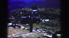 1958: a man on the rocky side of a hill smoking a cigarette COLORADO Stock Footage