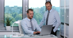 Successful Businesspeople Communication Using Computer Laptop in Office Interior Stock Footage
