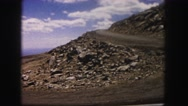 1958: curving road cutting through mountainous slope at high elevation COLORADO Stock Footage