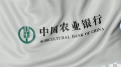 Close up of waving flag with Agricultural Bank of China logo, seamless loop Stock Footage