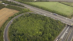 Busy junction of highway motorway, fast forward motion, aerial footage Stock Footage