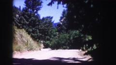 1958: shade covered mountain road escape sunshine happy place COLORADO Stock Footage