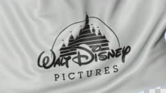 Close up of waving flag with Walt Disney Pictures logo, seamless loop, blue Stock Footage