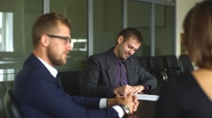 Male realtor with key and young couple from back Stock Footage