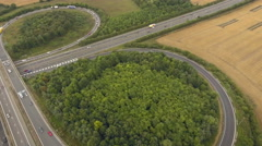Two motorway intersection with busy traffic, aerial footage Stock Footage