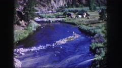 1958: mountain river running below bridge above view COLORADO Stock Footage