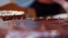 Making a chocolate cake. Almost done. Finishing touches Stock Footage
