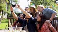Friends taking selfie at party in summer garden Stock Footage