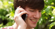 4k, Close up portrait of handsome young man using cellphone outdoors. Slow motio Stock Footage