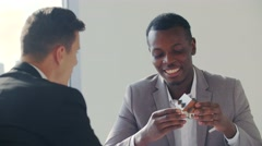 Real-estate black agent with man signing contract in white office Stock Footage