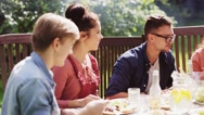 Happy friends having dinner at summer garden party Stock Footage