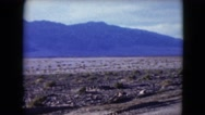 1957: snow accumulation and avalanche blocks road in the middle of a desert Stock Footage