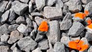 Man paints gray stone color paints brush close-up Stock Footage