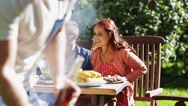 Happy friends at barbecue party in summer garden Stock Footage