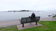 Hipster girl sit alone at waterfront, small yachts sail at calm waters Stock Footage