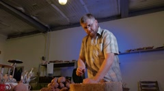 Pottery workshop, the man mixes the clay, medium shot Stock Footage